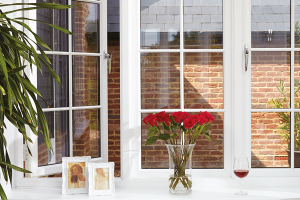 window sill with vase of flowers